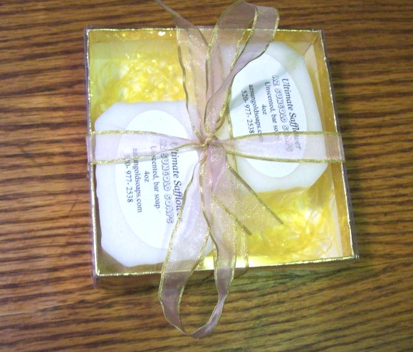 Two-Piece Gold Gift Box with acetate top filled with three bars of 'Ultimate Safflower' bar Soap & one soap saver.